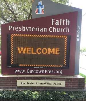Church sign on Main Street with welcome message